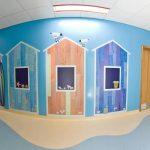 Wall cladding printed with fun beach hut gallery design