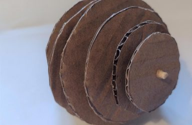 different sized corrugated circles threaded on a stick