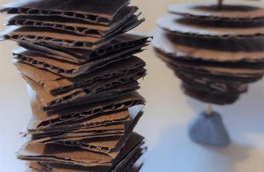stack of small corrugated card squares on a stick