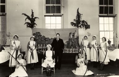 Nurses on ward holding bow and arrows