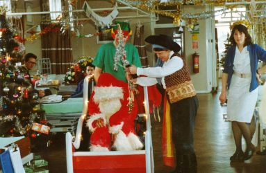 Father Christmas in sleigh with tinsel decorated ward