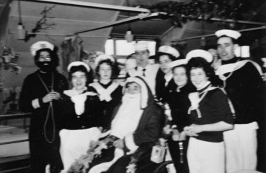 Father Christmas with staff in fancy dress costumes