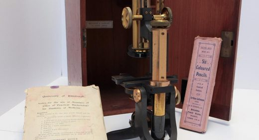 1920s metal optical microscope with wooden box, University of Edinburgh notes and pack of six coloured pencils in pink box