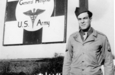 Soldier posing by the hospital sign