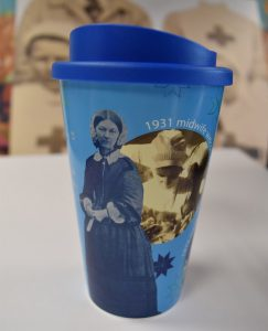blue lidded reusuable plastic cup with historical images of nursing and Florence Nightingale from hospital archive