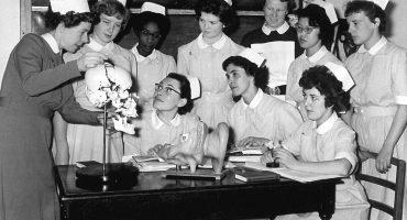 Sister showing group of nurses jawbone on skull