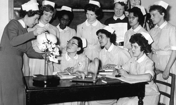 Sister showing group of nurses jawbone on skull