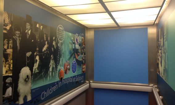Montage of historical images in lift interior