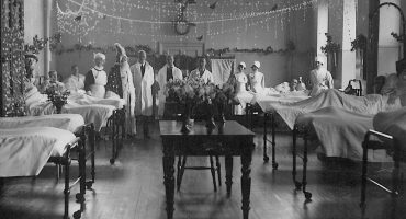 Doctors and nurses show off decorated ward for Christmas, 1930s