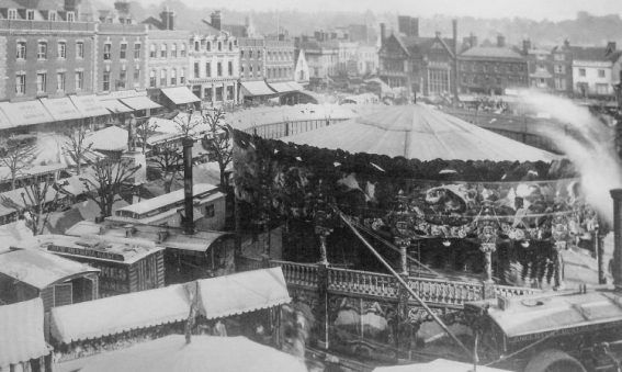 Steam carousel and wagons in Market Place, Salisbury