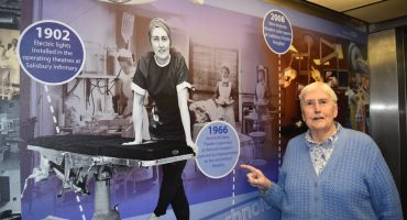 Jeanne Yates today points to photo of herself in 1966 displayed in hospital lift