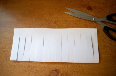 strips cut all the way along folded edge