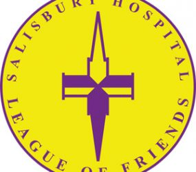 Yellow circle logo with purple spire