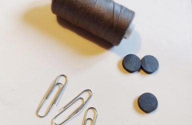 reel of cotton, magnets and paper clips