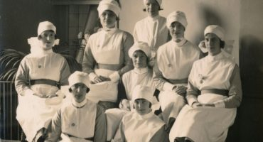 Midwifery students posing for photo in uniform