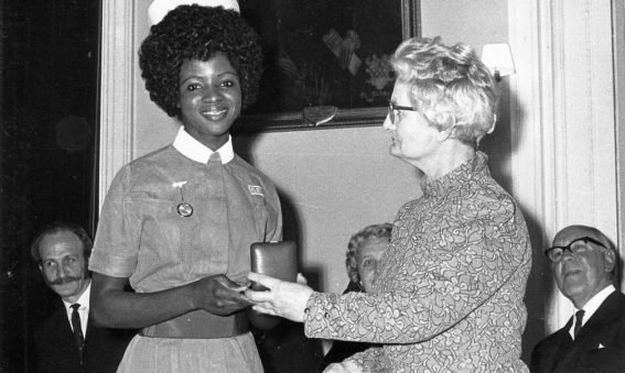 Nurse being presented with an award in a box