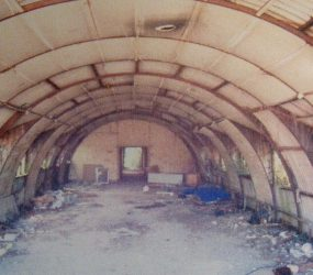 Derelict shell of nissen hut