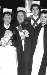 nurses in capes and white hats