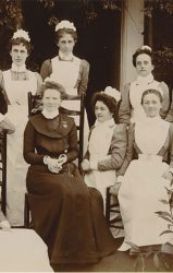 nurses with long aprons, dresses and filly hats
