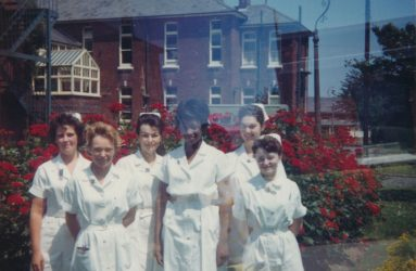 Student nurses stand for photo outside the home