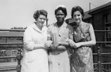 Three student nurses, one in uniform, two dressed in casual
