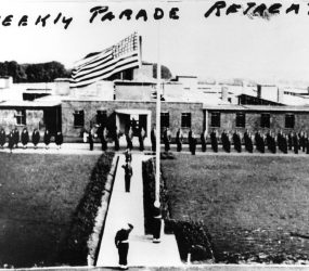 US army on parade with flag flying