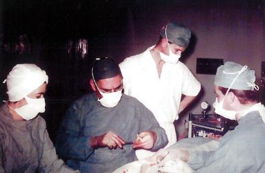 Surgeons carry out operation on patient