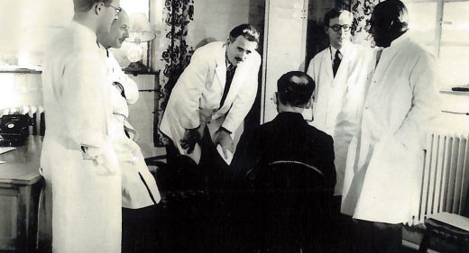 Dr Barron and colleagues consulting patient