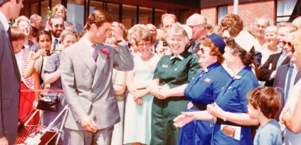 Prince Charles standing with crowds of staff and patients outside Spinal Unit entrance