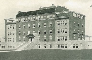 Hospital building on 5 levels, steps leading to covered porch entrance