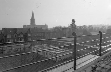 View across SGI rooftops, with cathedral spire in background
