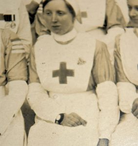 Unusual large leather wristwatch being worn by nurse